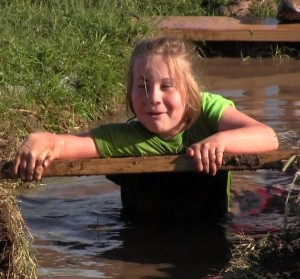 Little Girl in the Mud - Round Rock's Muddy Miler Family Adventure